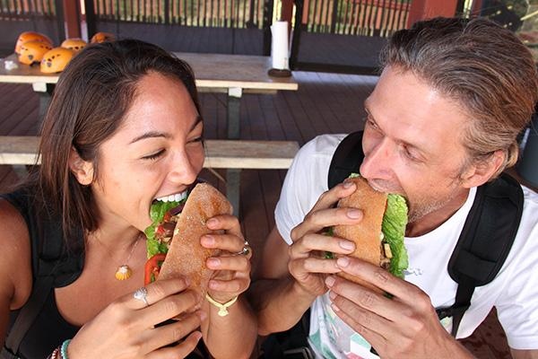 Hawaii food couple eating sandwich