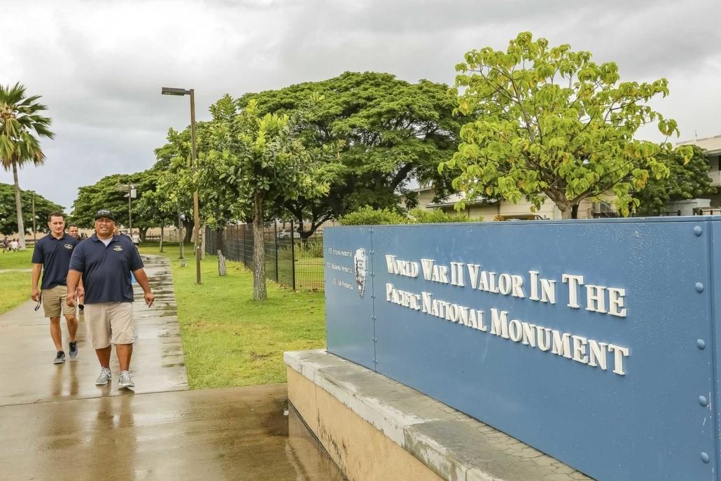 TourGuidesatPearlHarborEntranceSign Oahu