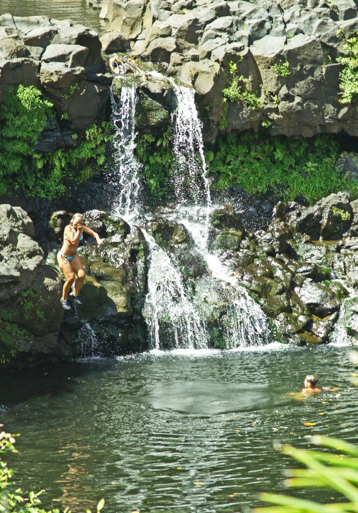 jumping into the waterfall pool