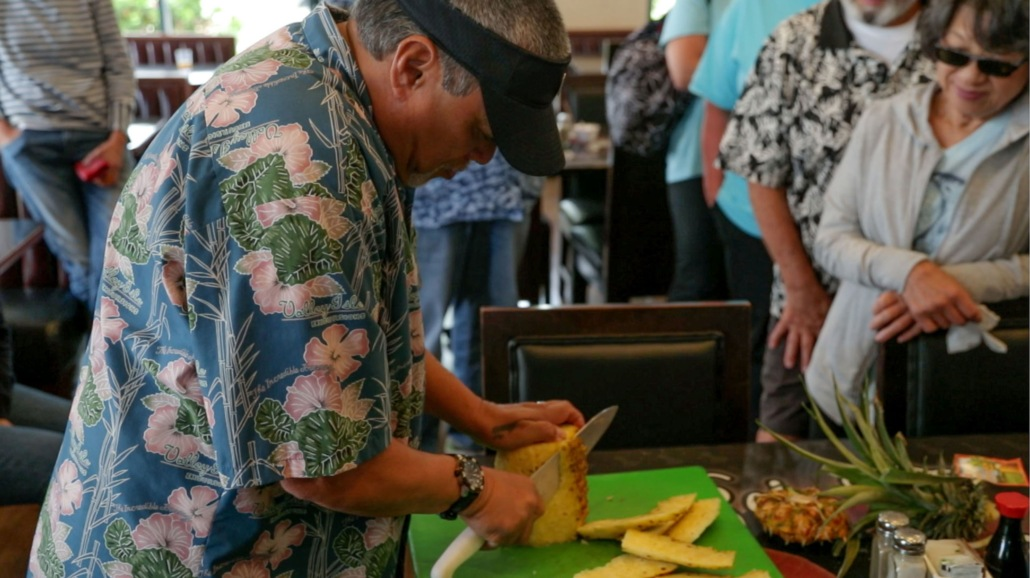 Guide Demonstrating Pineapple Cutting