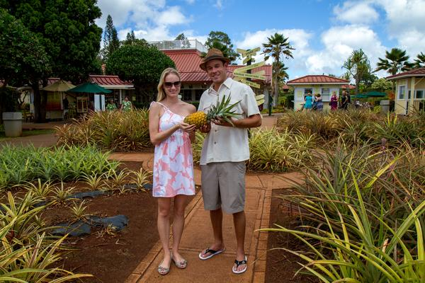 Visitors with Pineapple at Dole Planation