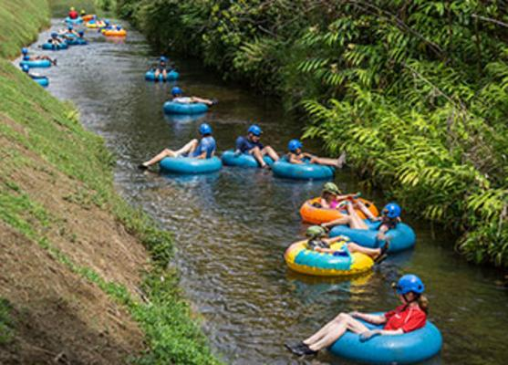 Mountain Tubing Visitors in Ditch Kauai
