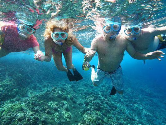 Snorkeling Family Underwater
