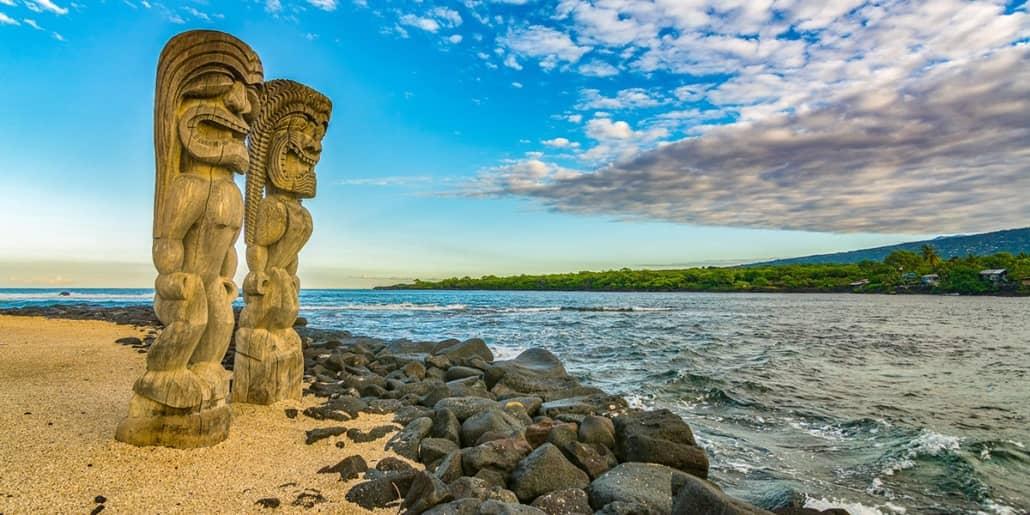 Historic Kona Side Tiki on Beach Big Island shutterstock_559143580 1200x600