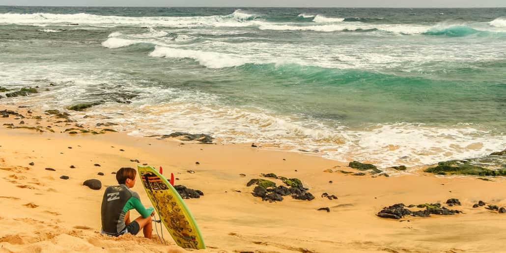 Sandy Beach Surfer and Board Oahu