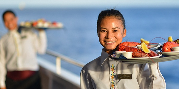 Star Of Honolulu DinnerCruises Deluxe Waiter with Food on Deck online vendor image for