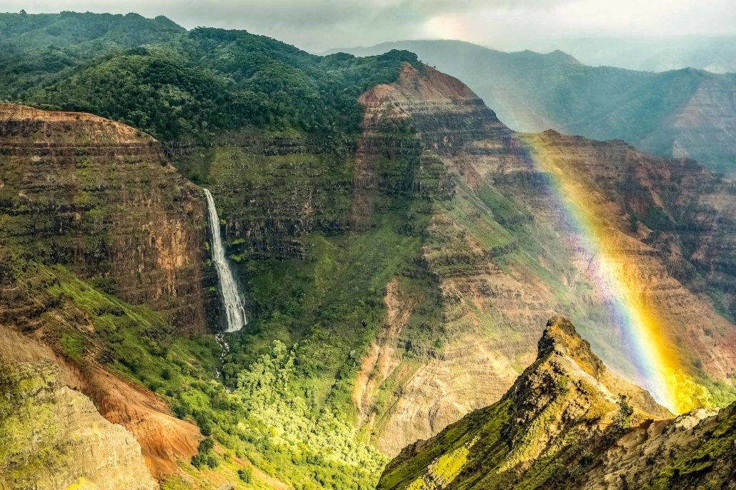 Waimea Canyon Waterfall and Rainbow Kauai shutterstock