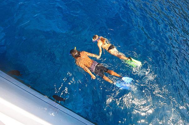 Snorkeling Couple Next to Boat
