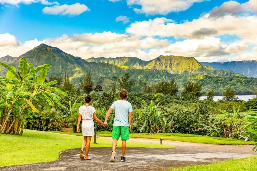 Kauai Princeville Couple Visitors Walking Road shutterstock_636062564