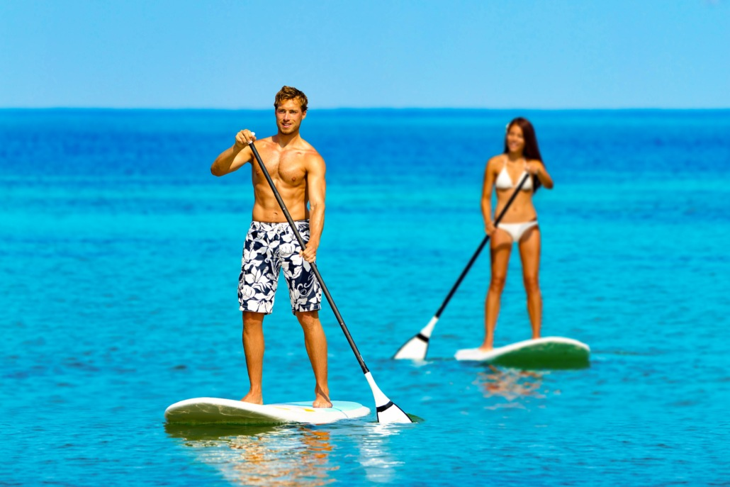 SUP Couple Visitors Ocean Paddle Boards shutterstock
