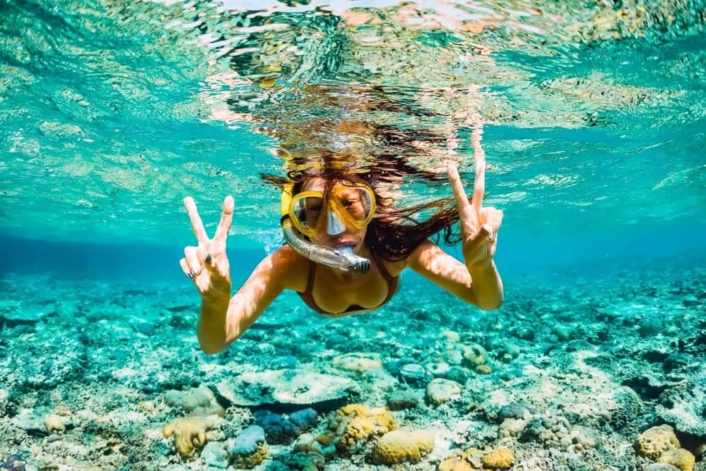 Snorkeler Underwater Ocean Reef Girl Hawaii shutterstock