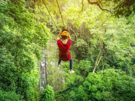 Zipline Kids Rainforest Waterfall Hawaii shutterstock