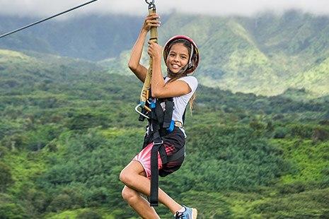 Girl Ziplining in Kauai Hawaii