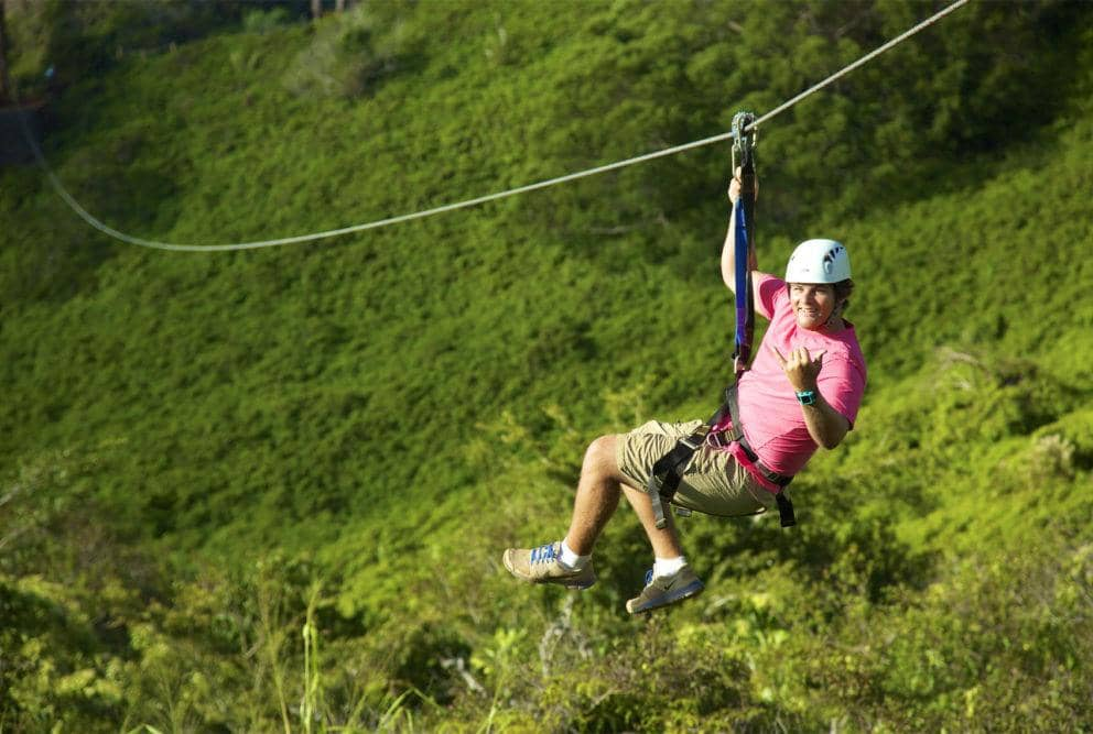 Man Ziplining at Poipu - Lihei