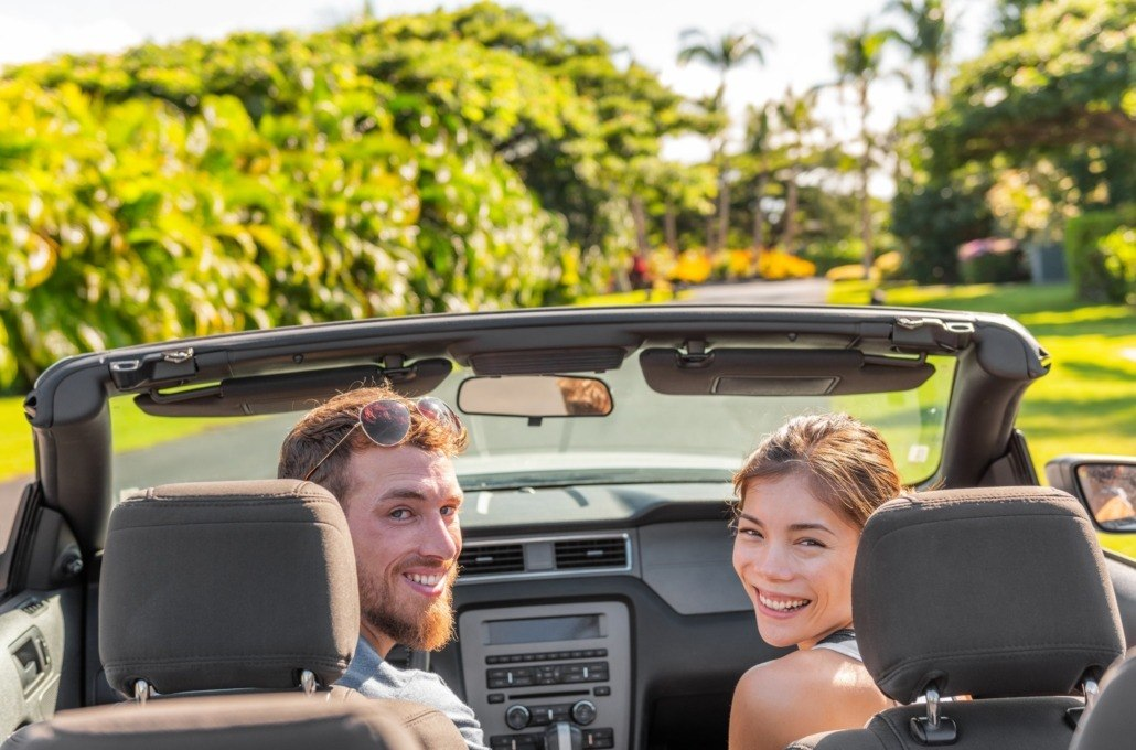 Couple in Hawaii Rental Car scaled