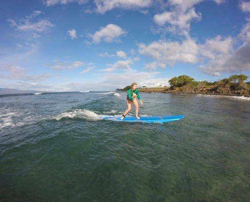SurfGirlGreenShirtSideShaka
