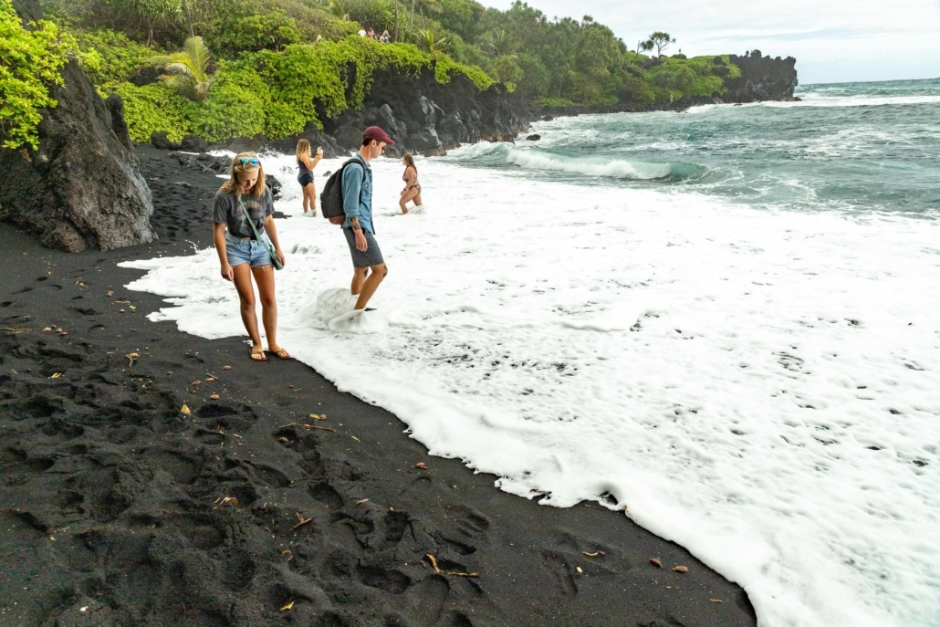 Black Sand Beach Visitors and Waves Road to Hana Maui
