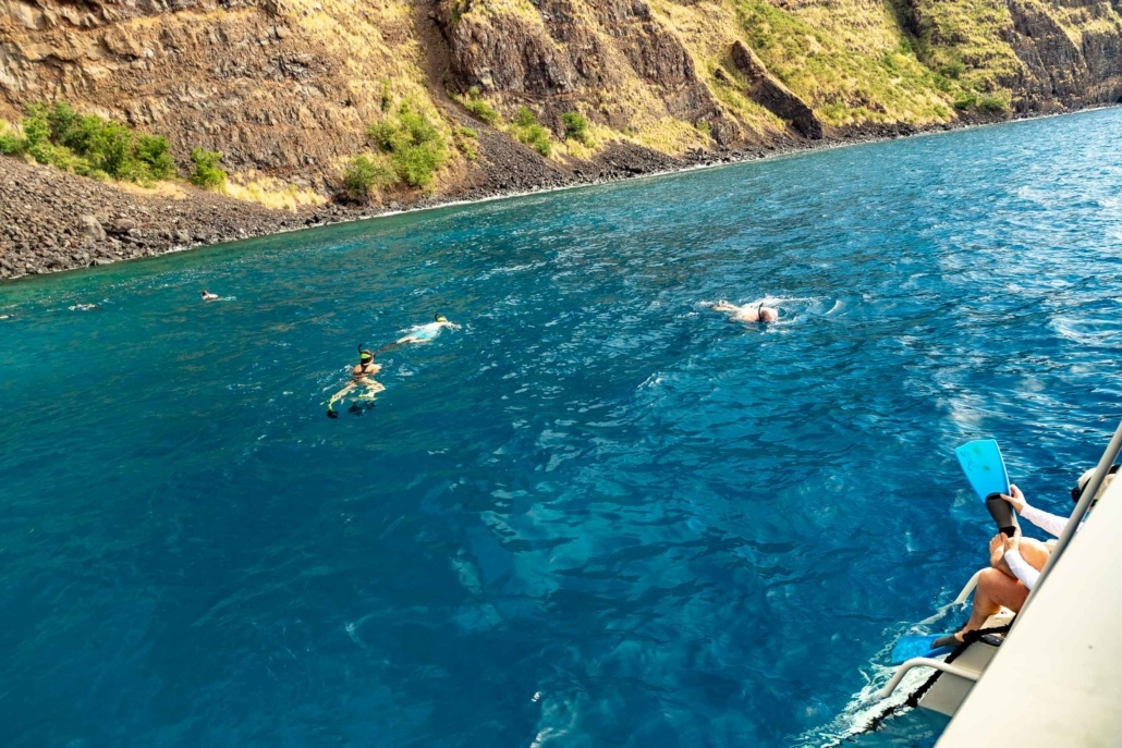 Snorkelers in Water and Boat Big Island