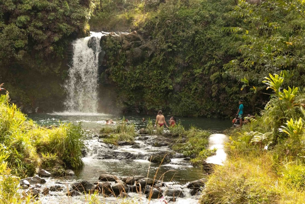 Visitors Swim at Waterfall Puua Kaa State Park Road to Hana Maui