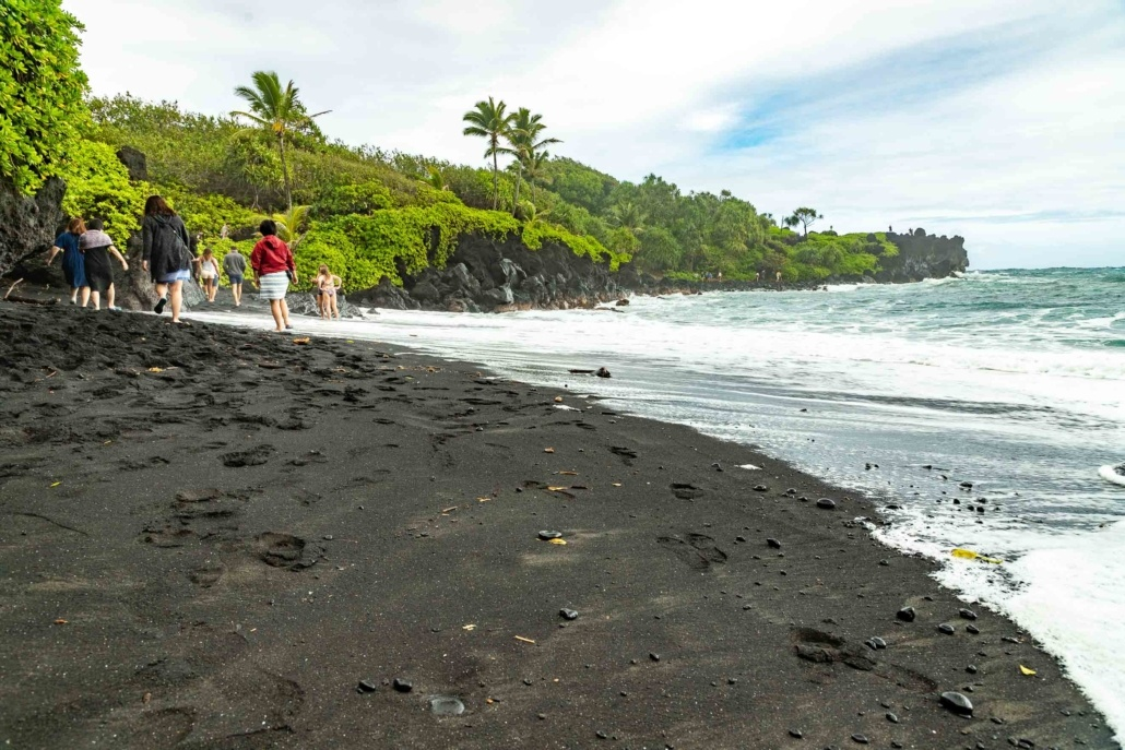 Visitors at Black Sand Beach Road to Hana Maui