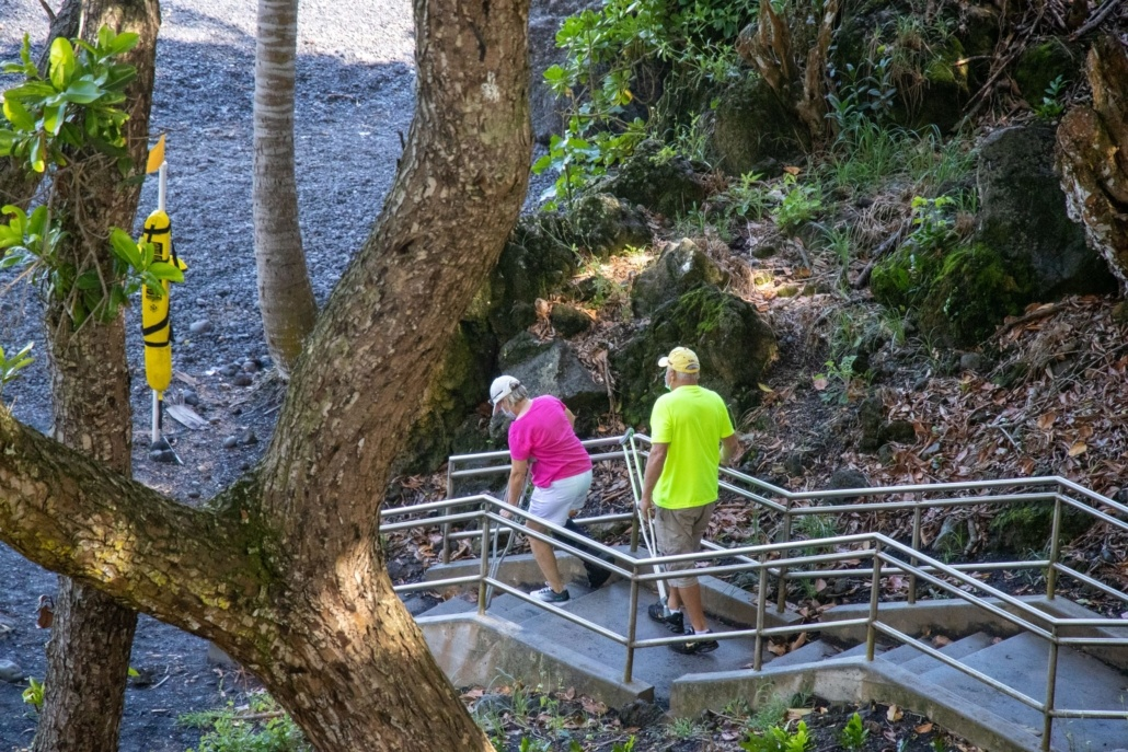 Waianapanapa Couple Going Down Stairs At Black Sand Beach