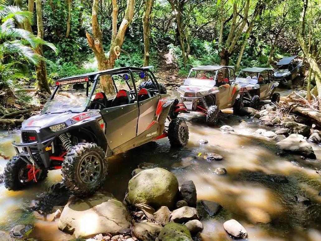 ATV Driving Over Creek in Maui