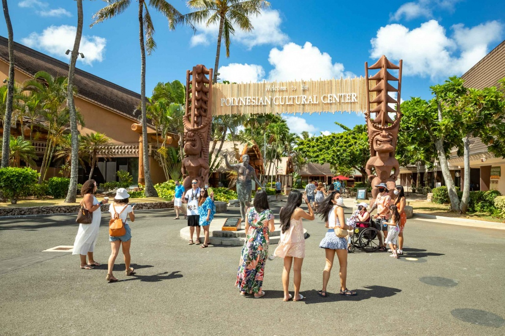 Polynesian Cultural Center Entrance Statue and Visitors Oahu