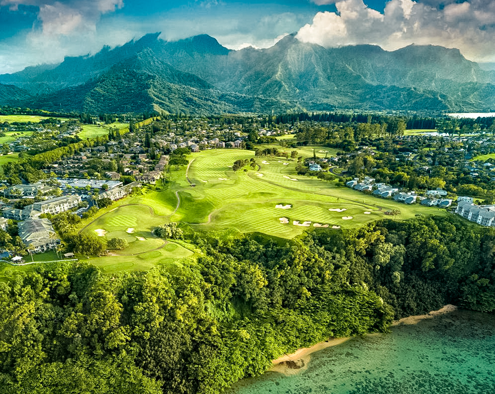 Princville Makai Course Hole_14_PM_Drone_Shot_with_BLUE_Sky,_Clouds_&_Reef